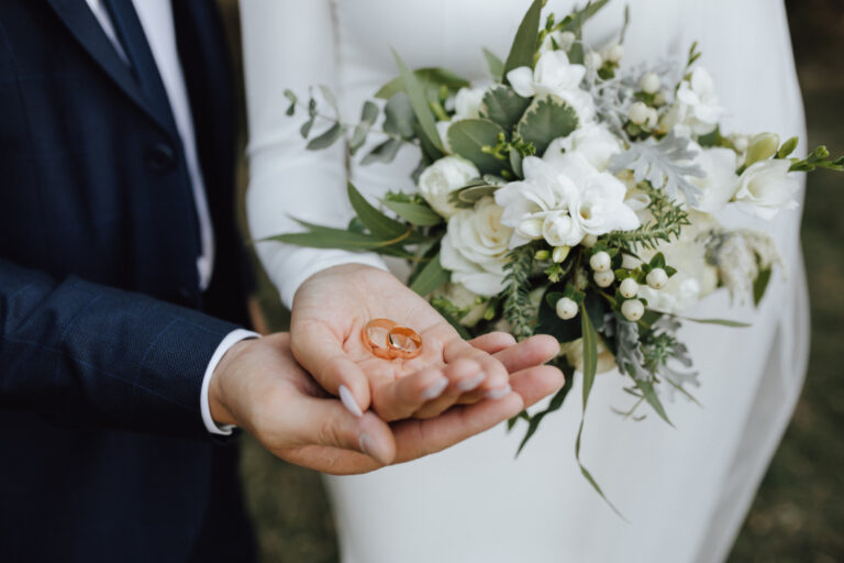 wedding-bands-hands-bride-groom-with-beautiful-wedding-bouquet-made-greenery-white-flowers